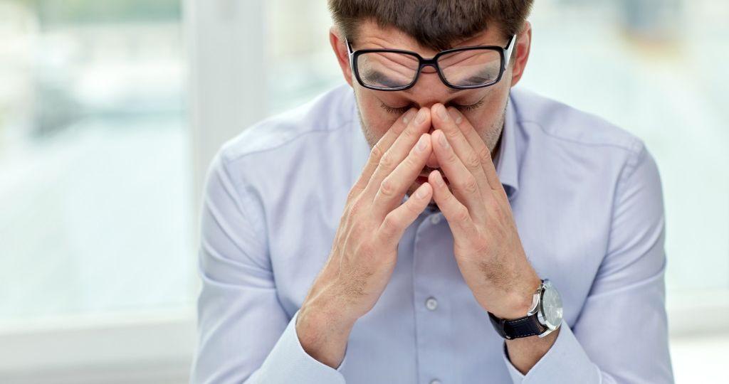 Man experiencing work fatigue
