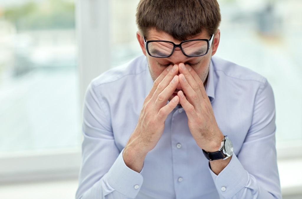Man experiencing work fatigue